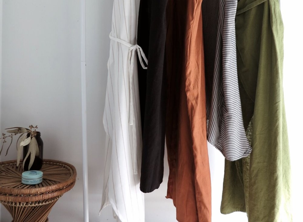 Round up any dresses or tops which have a similar style neckline and shape to the one you want to make. This makes creating the pattern pieces super simple.