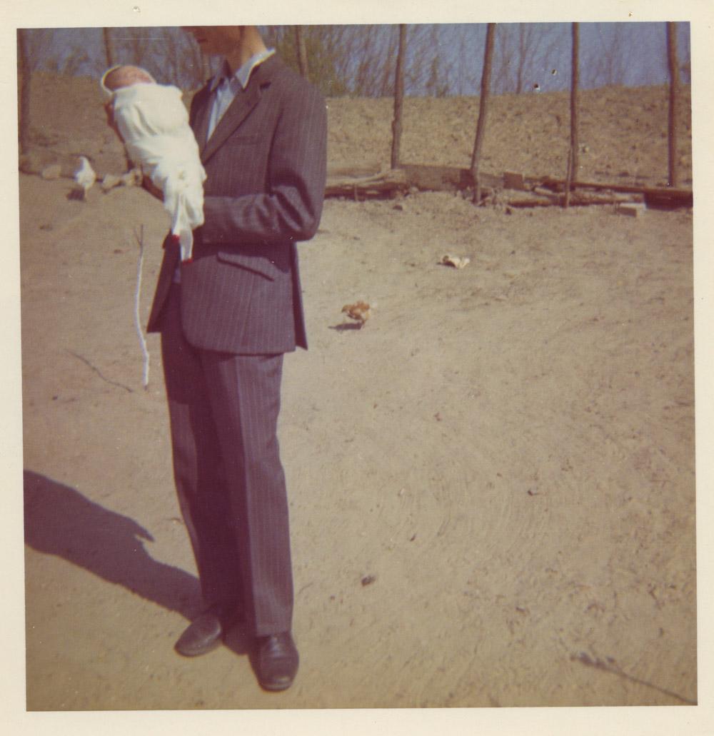 man holding a baby.jpg