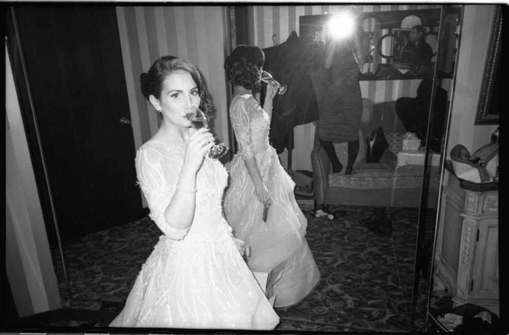 bride drinking champagne.jpg