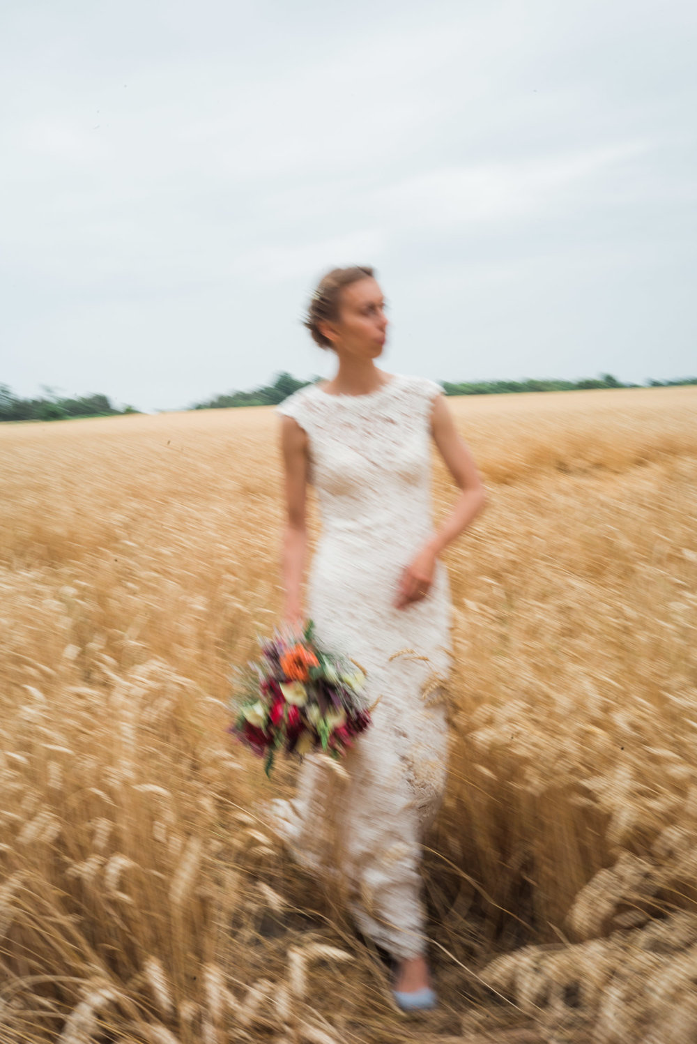 bride walking through field.jpg