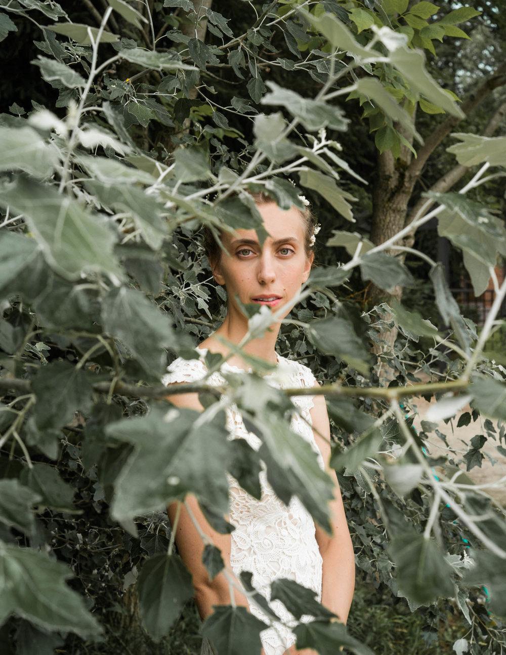 bride standing behind a tree.jpg