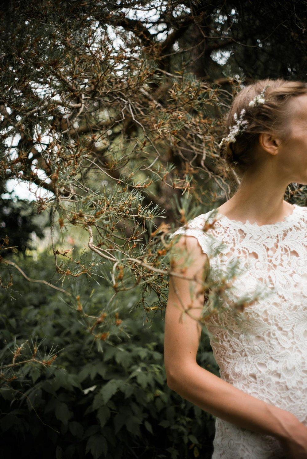 bride standing beside a tree.jpg