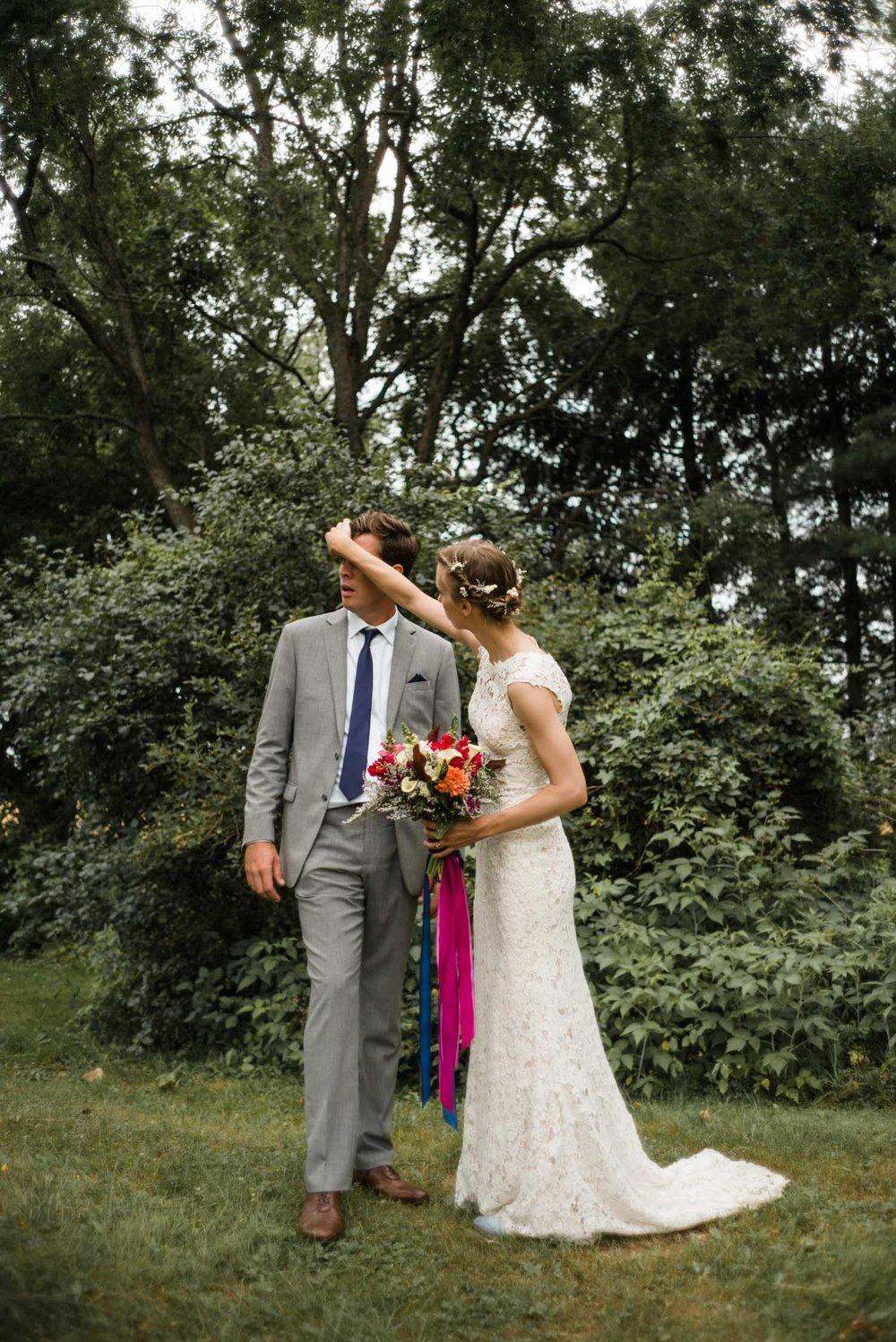 bride fixing grooms hair.jpg