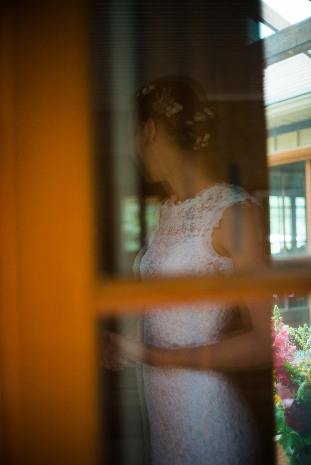 bride putting her dress on.jpg