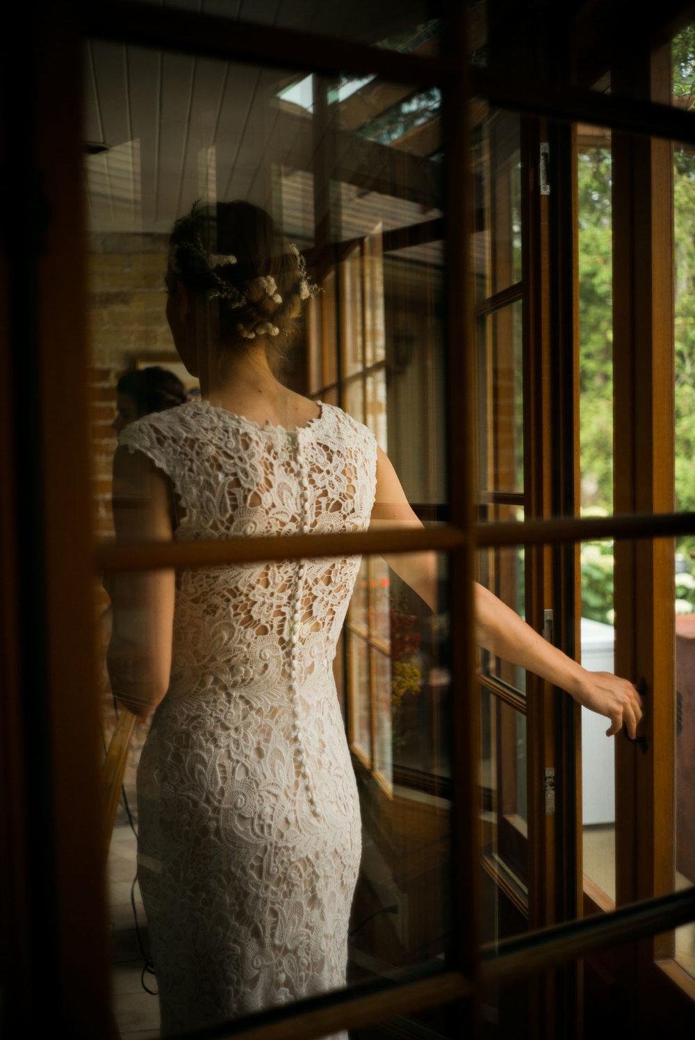 bride leaning on door frame.jpg