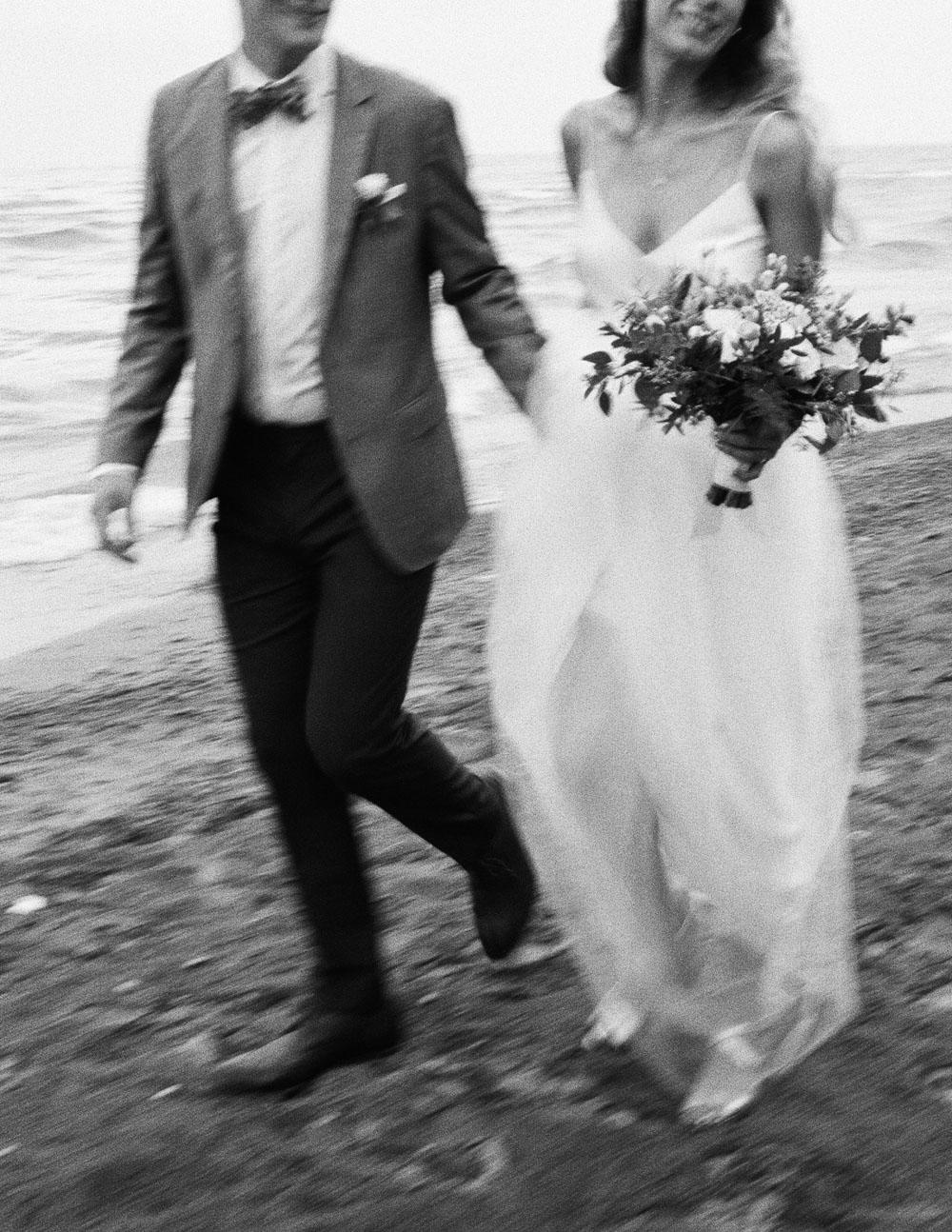 couple walking on beach.jpg