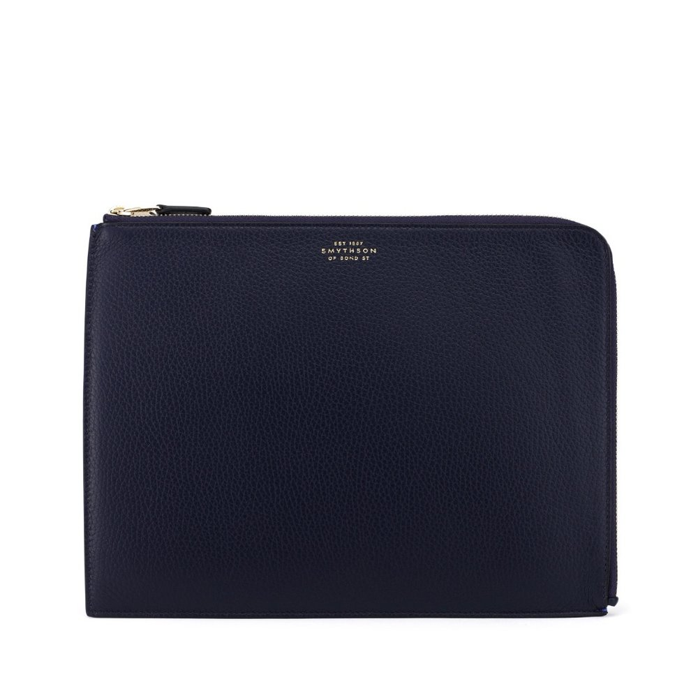 Queuing and airports are a thing. Accept this fact and have your travel docs ready at all times in this slim, leather Smythson travel pouch.