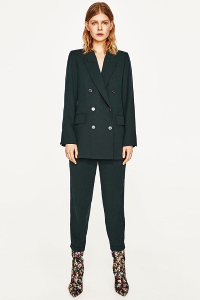 Lean In Green  High street favourite Zara nods to the 80s with this dark reinvention of the classic double-breasted suit and cropped trouser combo.    Jacket  - £69.99  Trousers  - £29.99