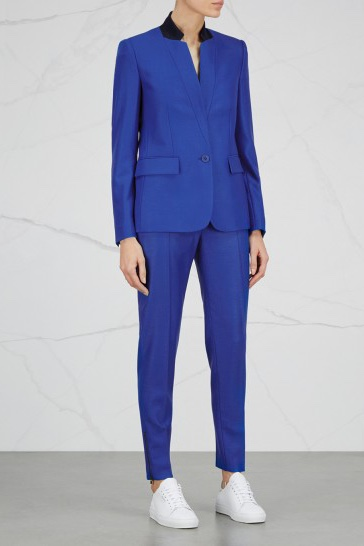 Bold and Blue  Narrow lapels and a charcoal collar give a modern twist to the bright blue wool blazer and slim-leg trouser of a certain Stella McCartney.   Jacket  - £895  Trousers  - £375