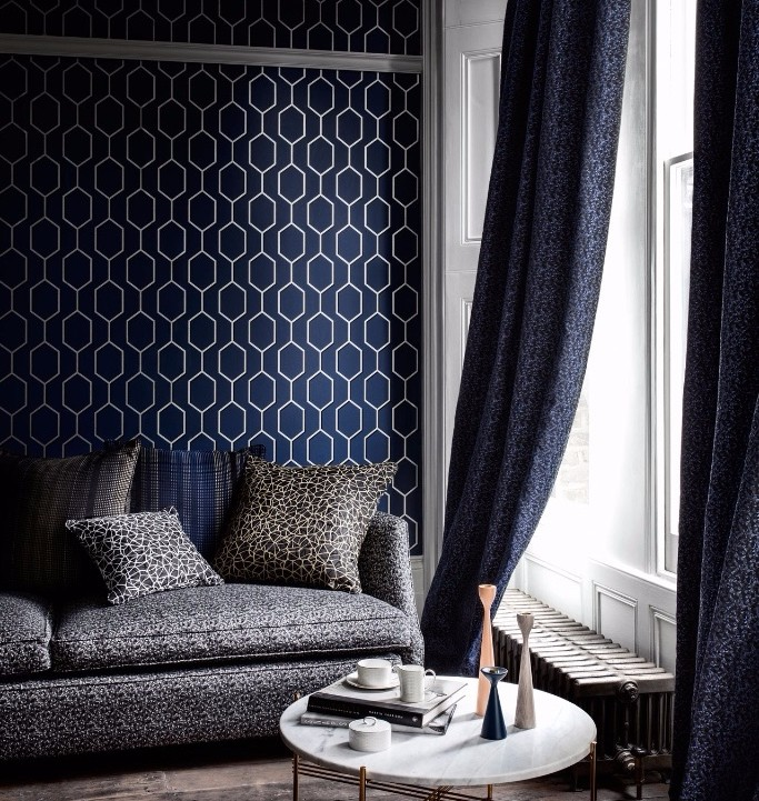 Midnight - The geometric pattern and metallic accents in this Wedgewood wallpaper (available fromTreadwells) contrast with the deep, moody midnight blue. Particularly suitable for creating dramatic living rooms and in larger spaces, keep it extra plush with dark drapes and patterned soft furnishings.