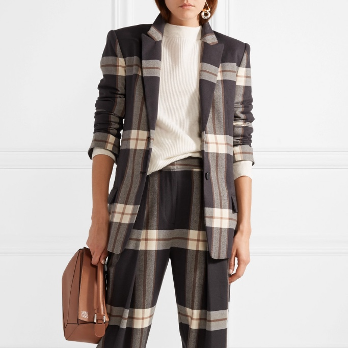- Malene Birger£350Tailored, yes. Padded shoulders, oui oui. Peak lapels, tick. The Vivaines blazer is checking(sorry) all the requirements on our blazer wishlist. Single-breasted means smart casj, so team with tailored trousers for work, or relax the look with well-worn jeans and a loose-fitting t-shirt underneath.