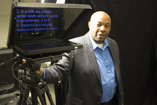 Aaron Ralph Thomas, founder and CEO of Your World Productions, Inc., with one of his teleprompters.