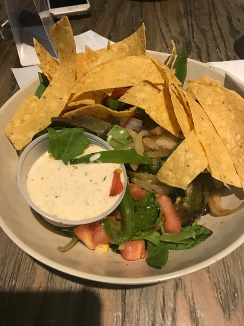 Mixed greens tossed with tomato, sauteed onions, red and green peppers, black beans, corn, jack cheese and tortilla strips in a cilantro lime ranch dressing for under $9.