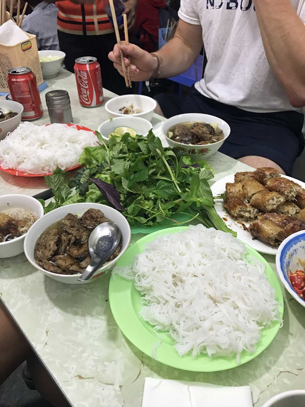 (Left) The Old Quarter, (Right) The crew enjoying bun cha in said Old Quarter: Bun Cha Nem Cua Be Dac Kim.