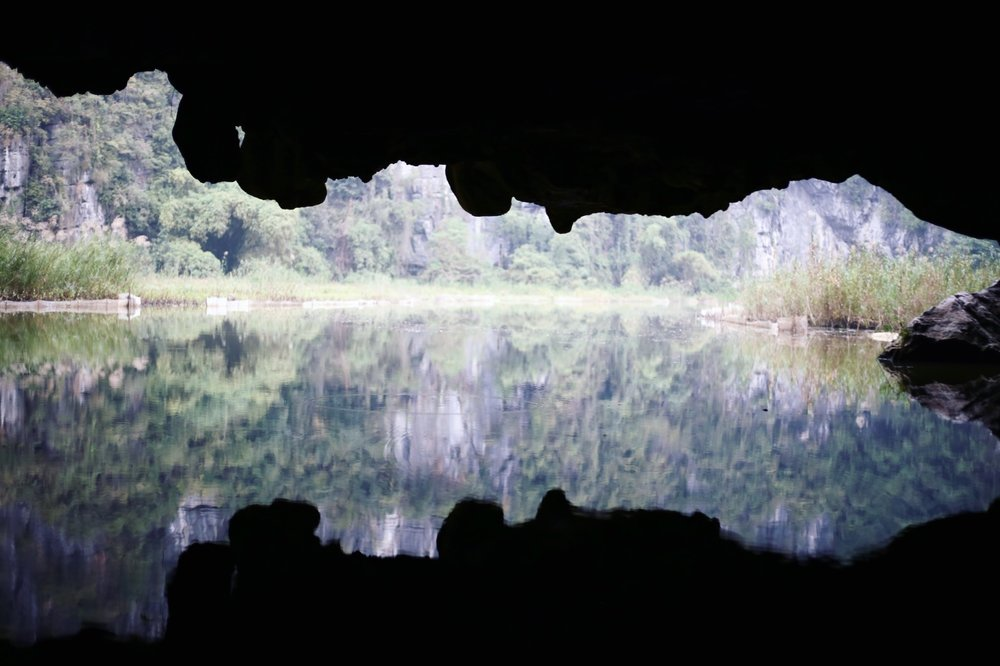 Coming out the mouth of a cave by boat at Tom Coc. Reminds me of a Rorshach test.
