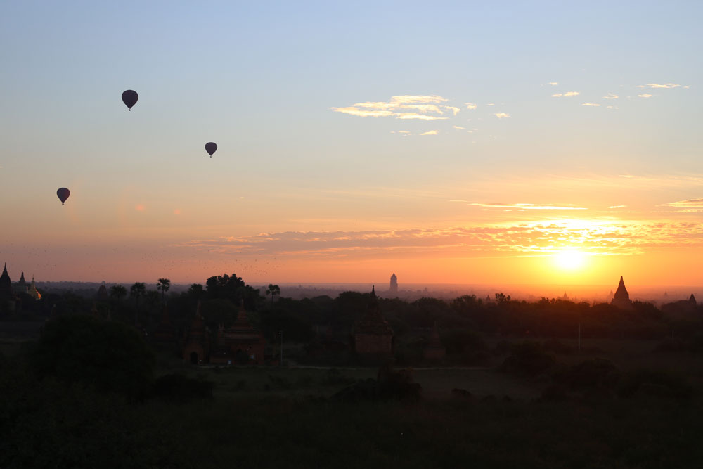 Balloons over Bagan at sunrise.