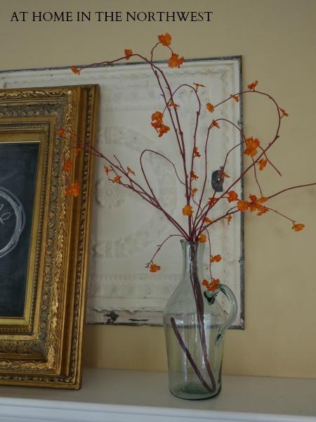 Fall mantel - orange flowers in vase