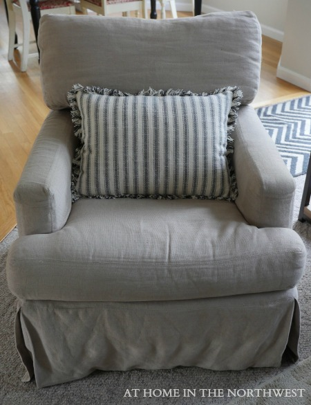 CRATE AND BARREL SWIVEL CHAIR LINEN FABRIC AND WORLD MARKET STRIPE PILLOW