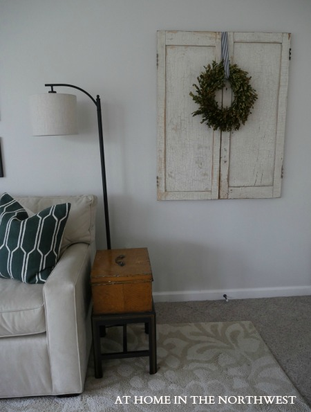 FAMILY ROOM ben moore classic gray old doors with wreath