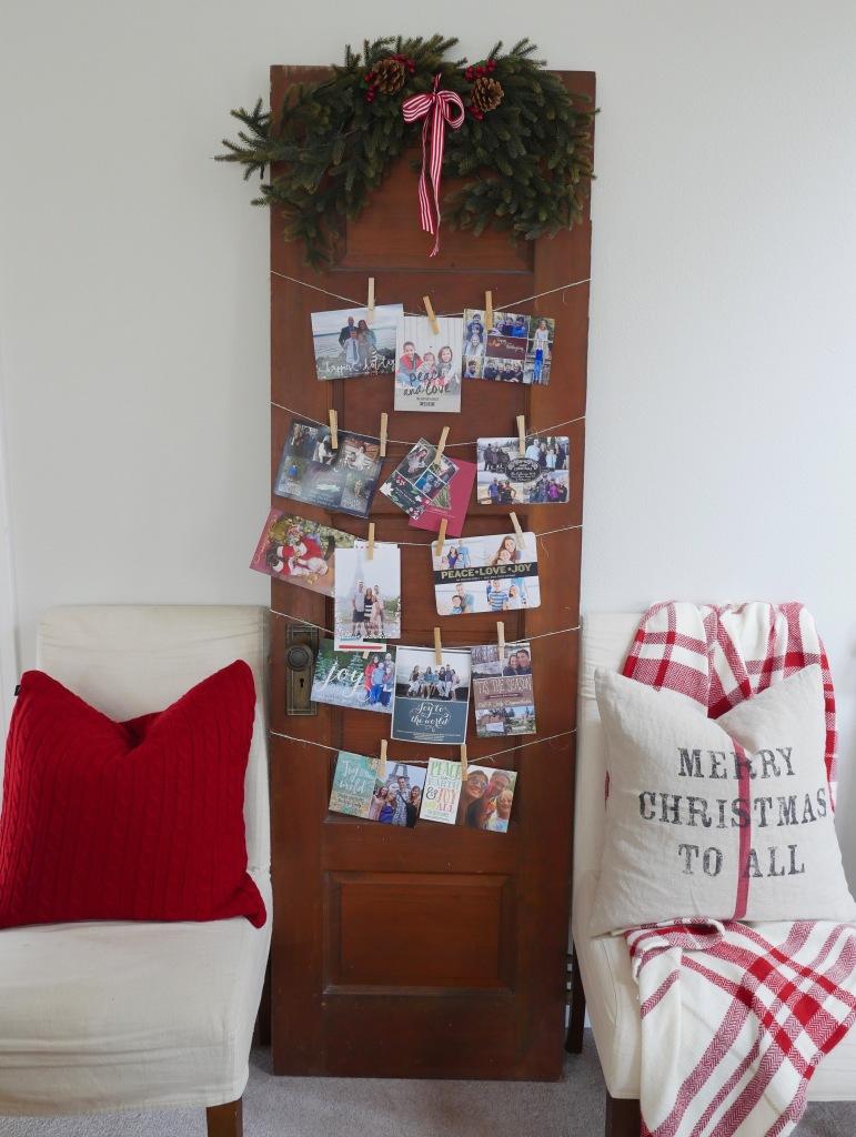 jen gilday interiors - use an old door to display christmas cards