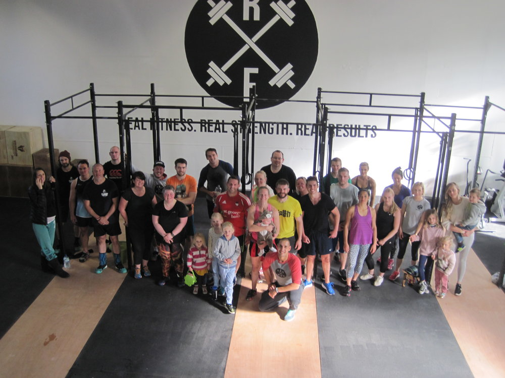 Picture of our members from our first workout in our newly opened gym