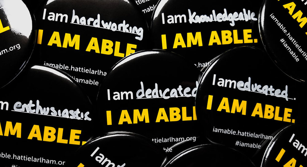 I Am Able campaign buttons. Write a positive word about yourself on the line.