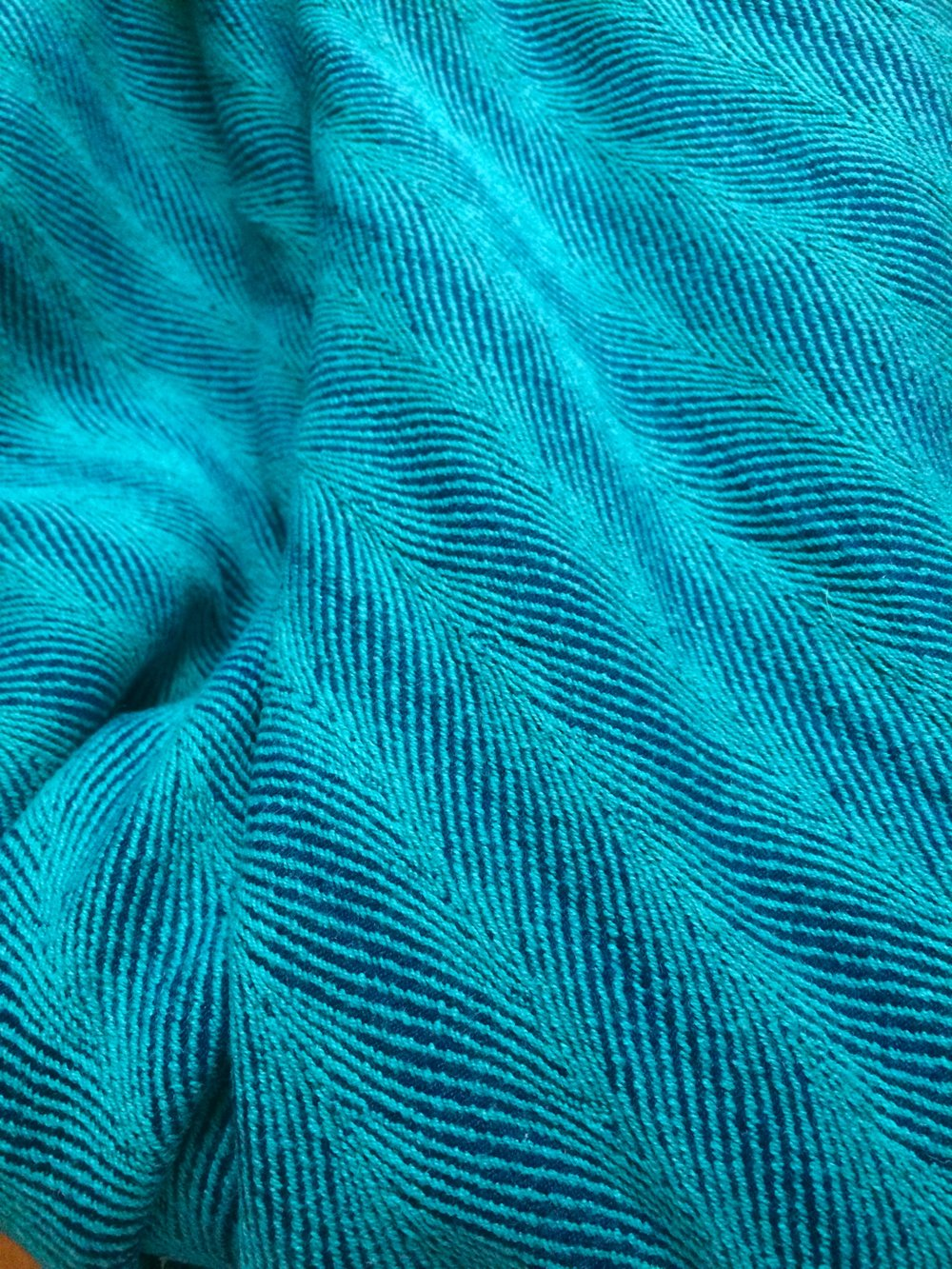 Close-up of Didymos Twisted Lisca Emerald
