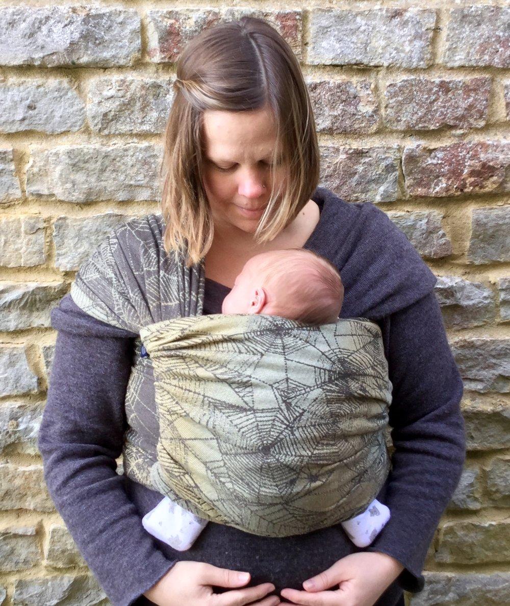 Firespiral Acorn Burnish Gossamer wrapping a newborn