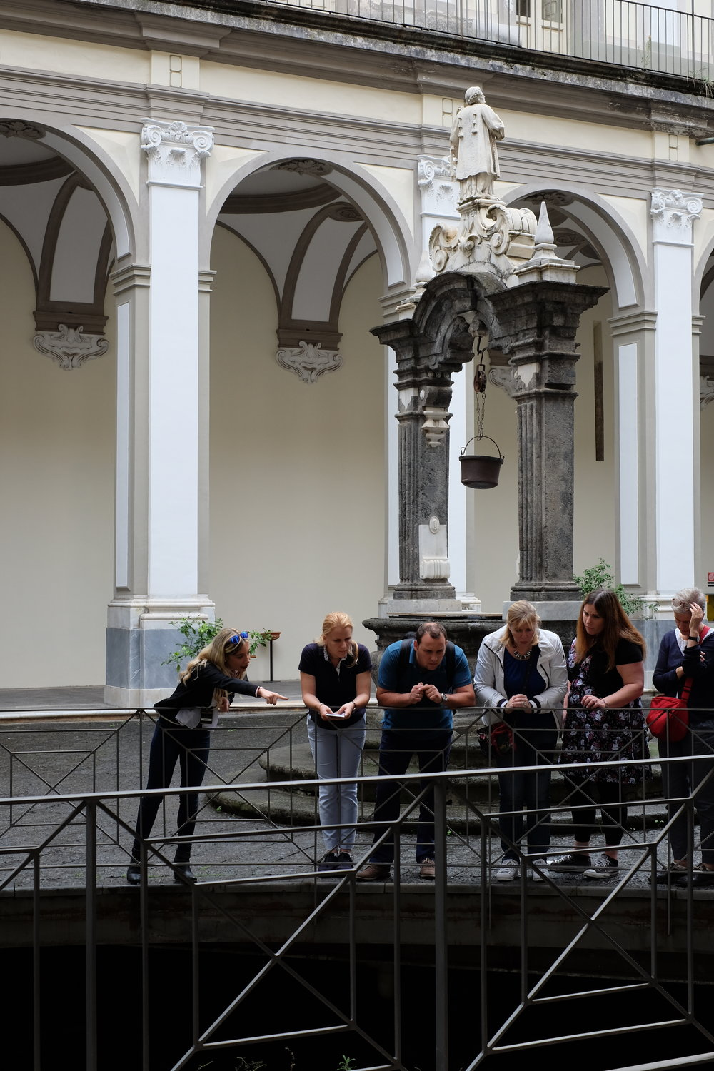 Guided tour, showing the underground origins of the church.
