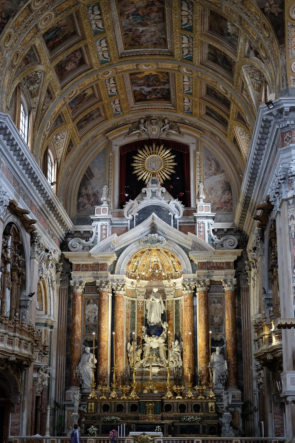 The high altar with the sculptures of  The Madonna and Saint Peter and Saint Paul  by Antonio Busciolano, dated 1857-59.  The ceiling-dome is decorated with paintings by Massimo Stanzione.