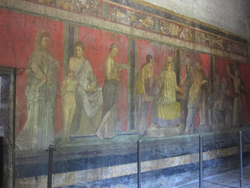 The vivid colours of the frescos in Villa dei Misteri.