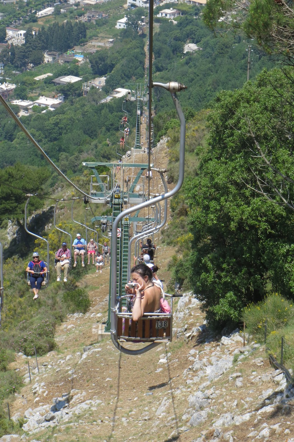 Someone seems to enjoy (or scared) the chairlift!!.