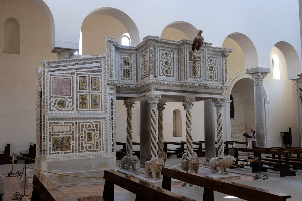 "The marble ""pulpit of the gosples"" created in 1272 by Nicolò di Bartolomeowith elegant mosaic decorations."