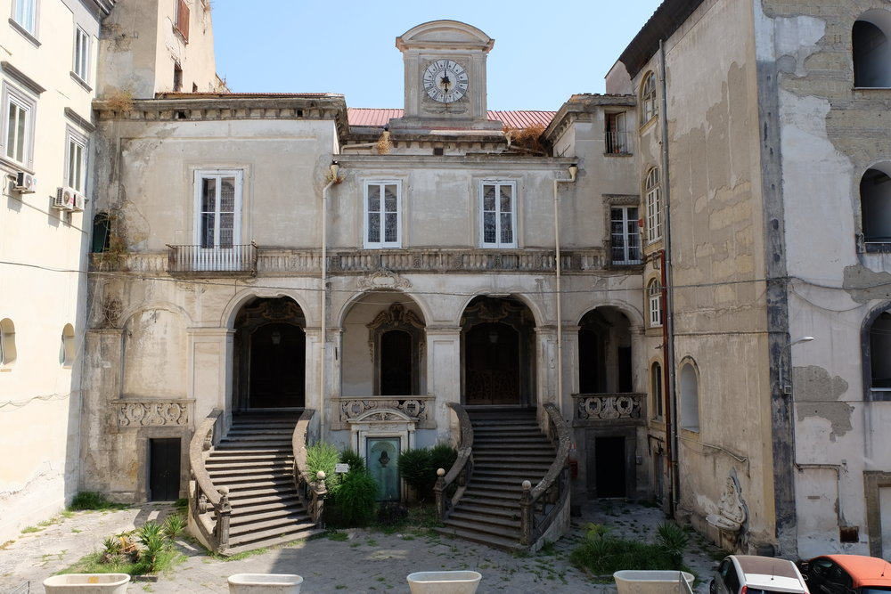 Façade of the Pharmacy of the Incurabili located in the courtyard of the hospital. Still standing before the entrance are the marble baths where the sick were washed before entering the hospital.