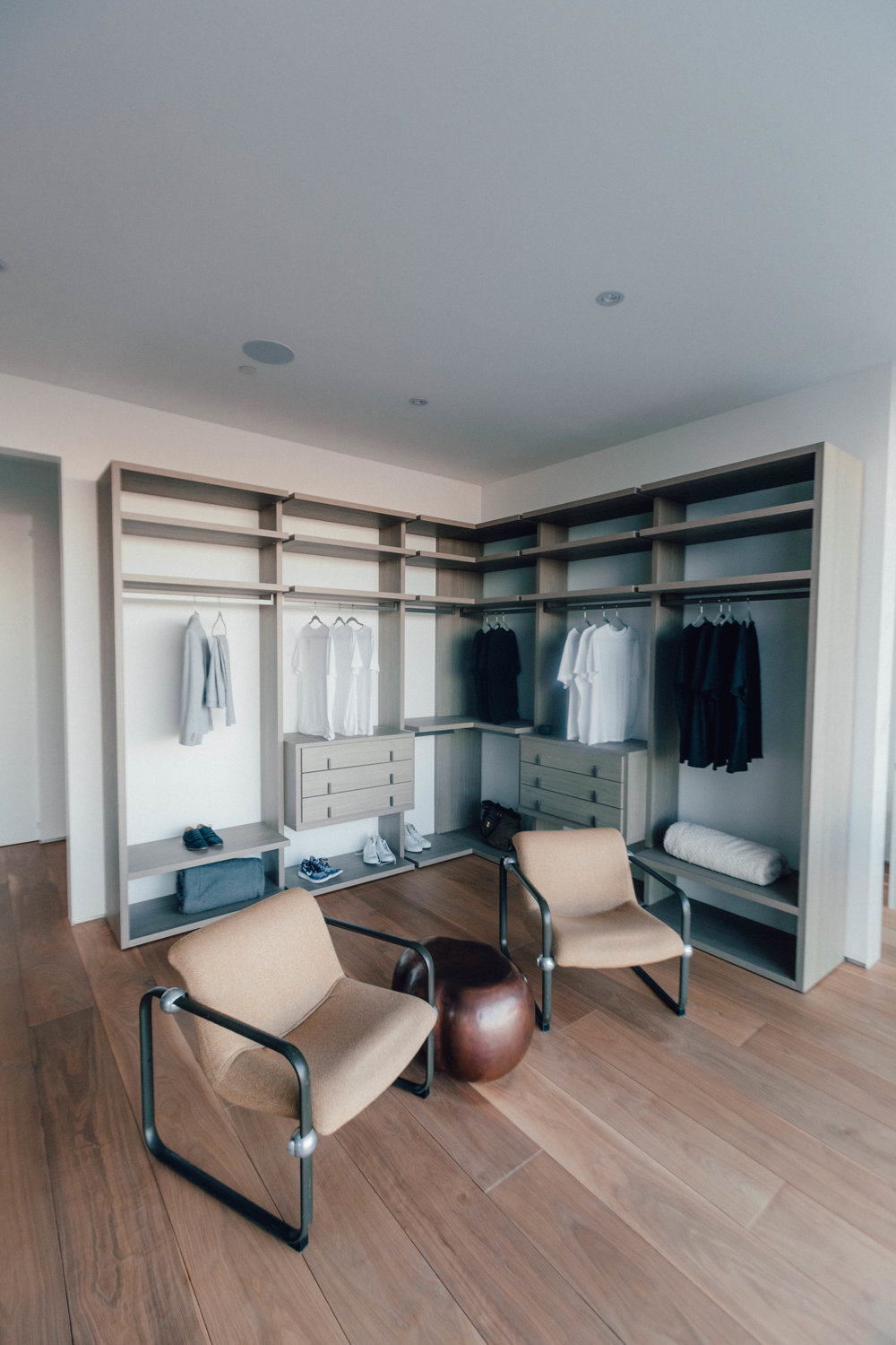 Example of custom furniture of bespoke shelving in place in an open plan scheme via eDesign online for a San Fransisco from Berlin design interior studio