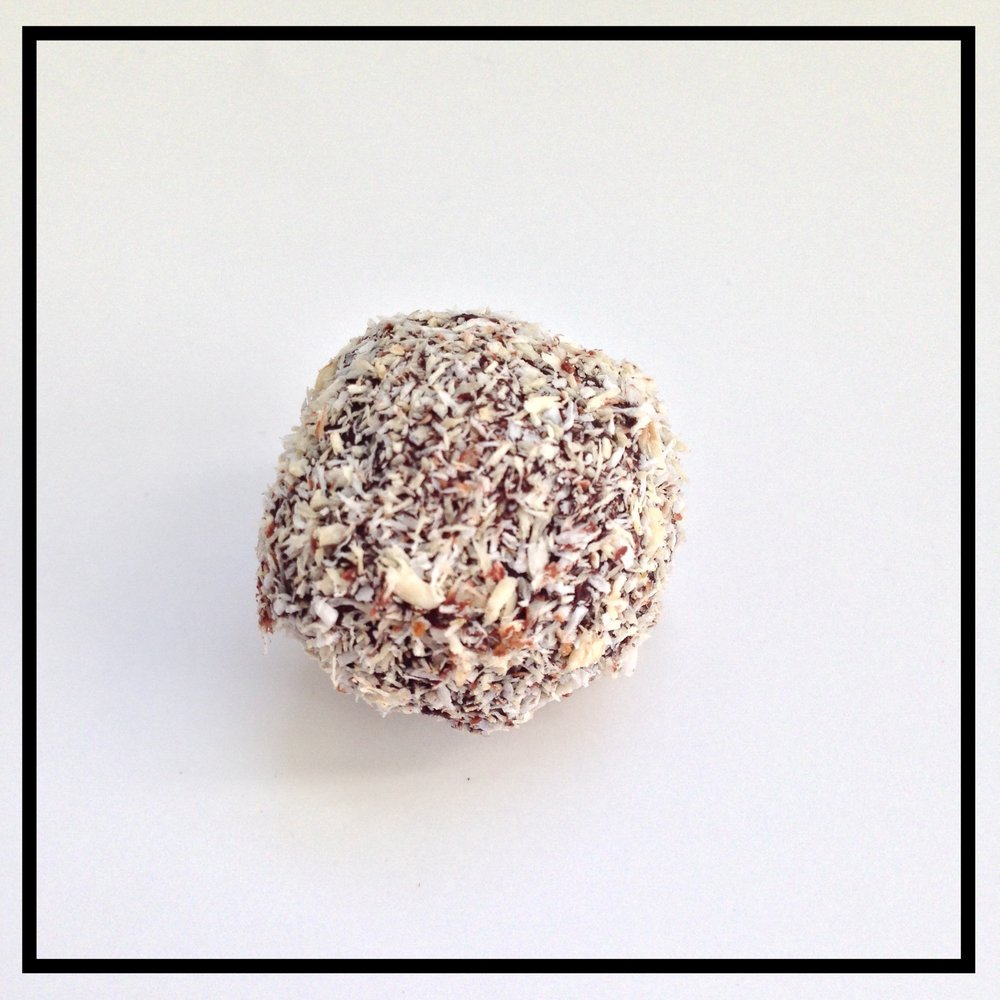 COCONUT   Shredded coconut and chocolate ganache coated in toasted coconut