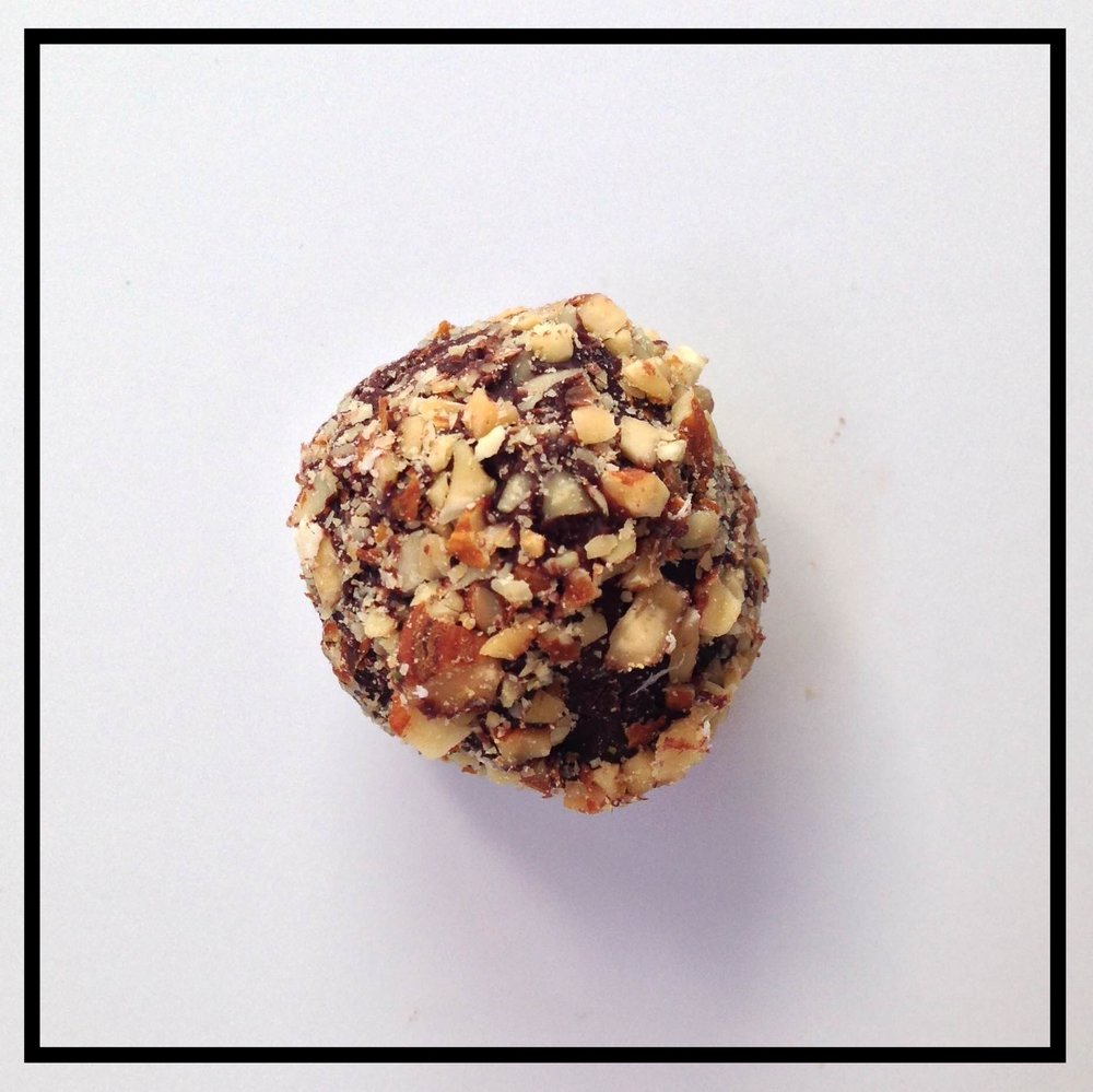 AMARETTO   Amaretto di Saronno blended into chocolate ganache, coated in crushed almonds