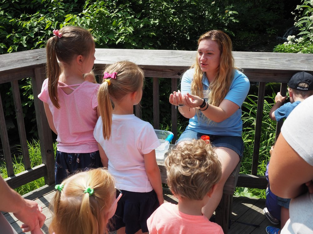 Zoe hosting an outdoor portion of the July Wee Ones Walk for children ages 3-5.