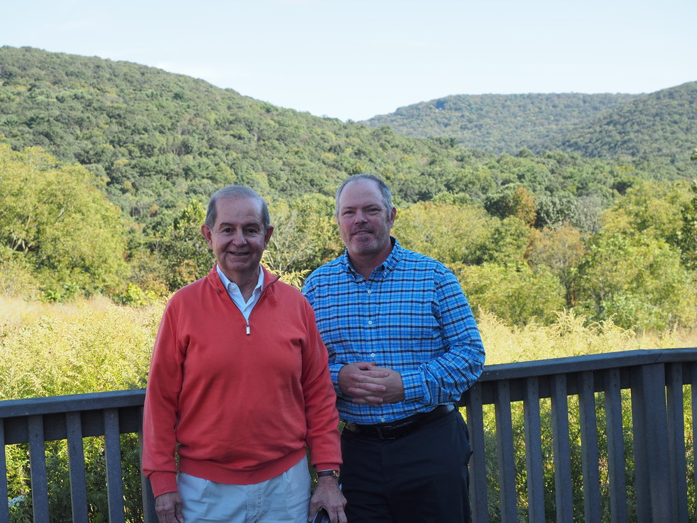 Ben Olewine with Hawk Mountain President Sean Grace stand outside the Acopian Center for Conservation Learning.