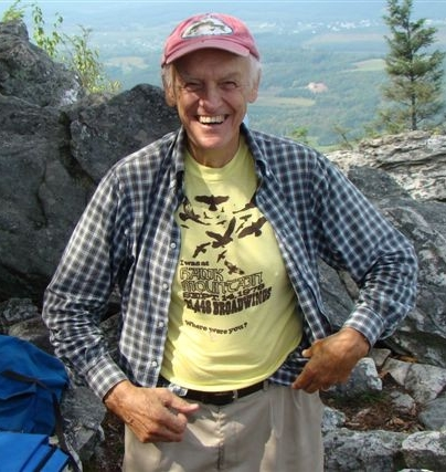 "Warner witnessed Hawk Mountain's Miracle Day on September 14, 1978, when counters tallied a record 21,448 broad-winged hawks. Here he proudly displays his ""I was here"" t-shirt."