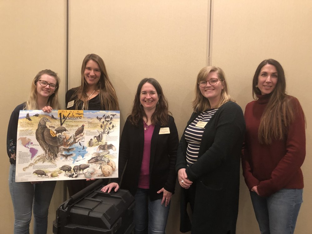 Hawk Mountain educators who attended the PAEE 2019 Conference, posing with HMS educational materials. From left to right: Shannon Lambert, trainee; Zoey Greenberg; leadership trainee; Andrea Ambrose, educator; Riley Davenport, trainee; Erin Brown, director of education.