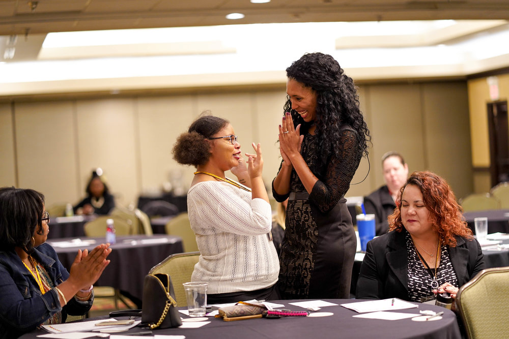 Lindsey Vertner encouraging an attendee that was moved by Lindsey's words at a women's empowerment conference.