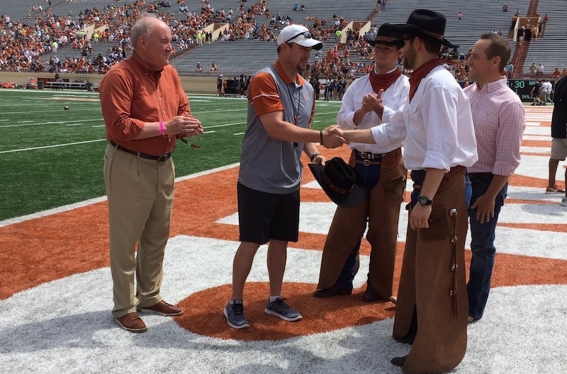 Mike Perrin, athletic director & former Cowboy; Tom Herman, head football coach; Ryan Baumgartner, Fall '16 Foreman; Eli Sterbcow, Spring '16 Foreman (shaking Herman's hand); Ace Schlameus, President of Alumni Board.