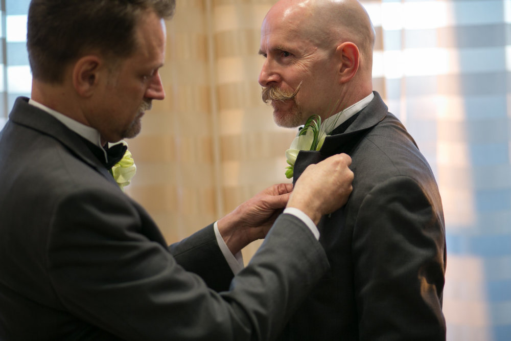 Above is an image of the happy grooms making sure things are perfect prior to the ceremony.