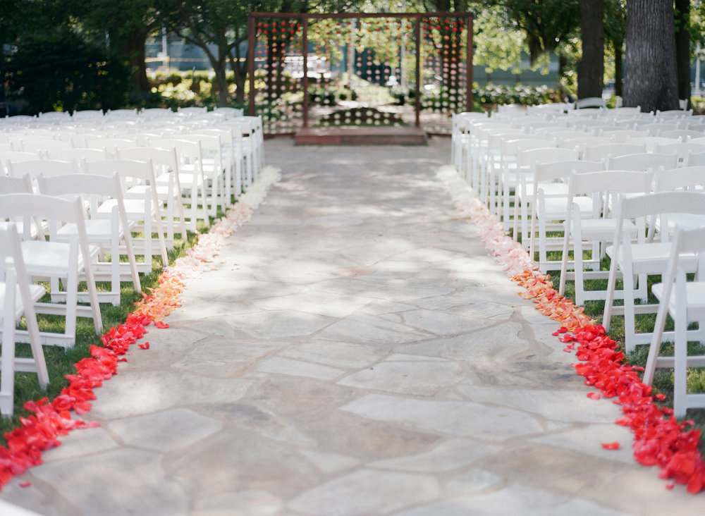 The ombre wedding aisle held up perfectly even in the breeze as the colors moved from coral, orange, pink, blush and then to bright white.