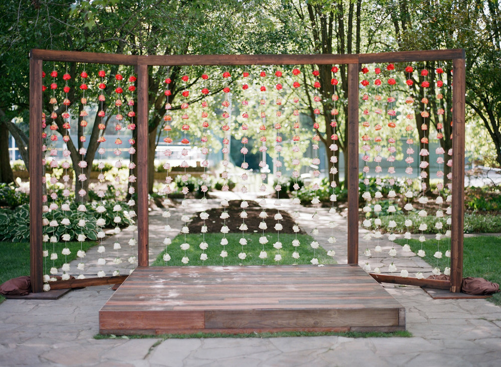 The backdrop was a collaboration with Exclusive Events Inc. They constructed a three sectioned arbor that provided Festive with a space to create the ombre rose backdrop.