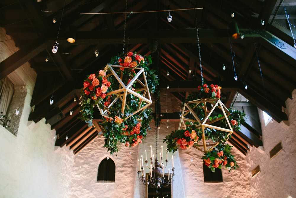 The floral and geometric treatment was another collaboration with Exclusive Events Inc. They produced a geometric chandelier that Festive treated with blooms and floral garland in the event theme. It was a fantastic way to bring a focal element to the ceiling.