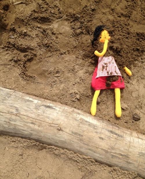 handmade rag doll with dirt