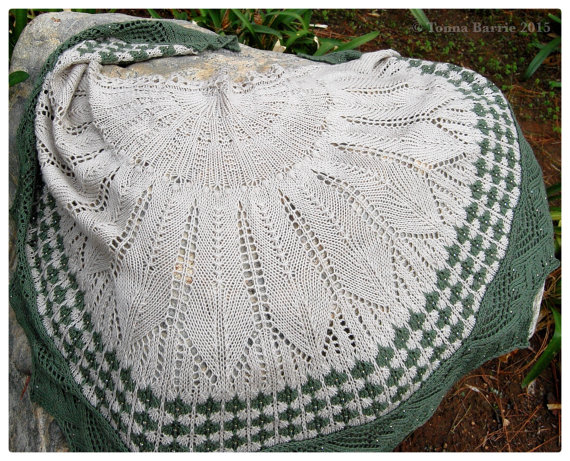 A beautiful hand knitted Beaded Cactus Flower Shawl from Daisydogknits