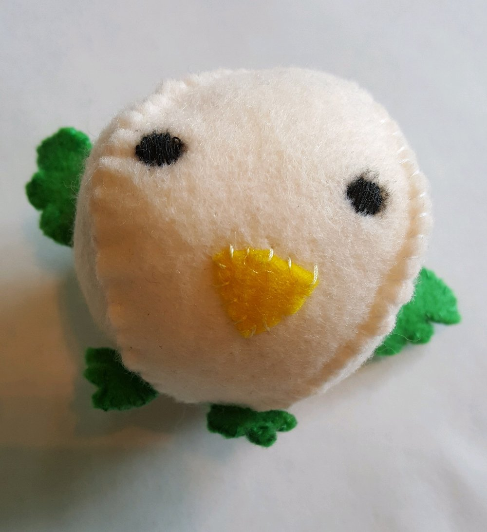 A little felt bird, handmade by Calista   (Little Birds book; see below)